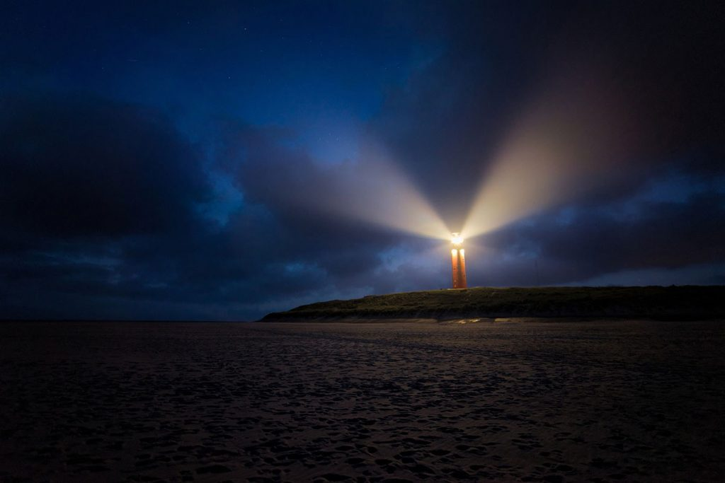 Lighthouse shining a beacon of light