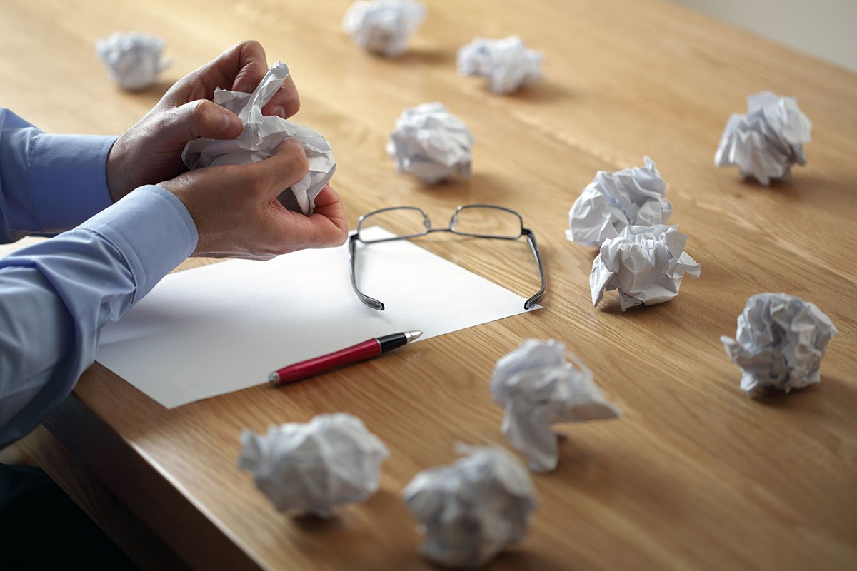 Screwed-up paper on desk