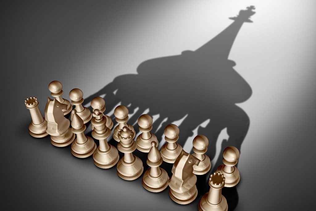 Chess set with pieces casting a bigger picture shadow