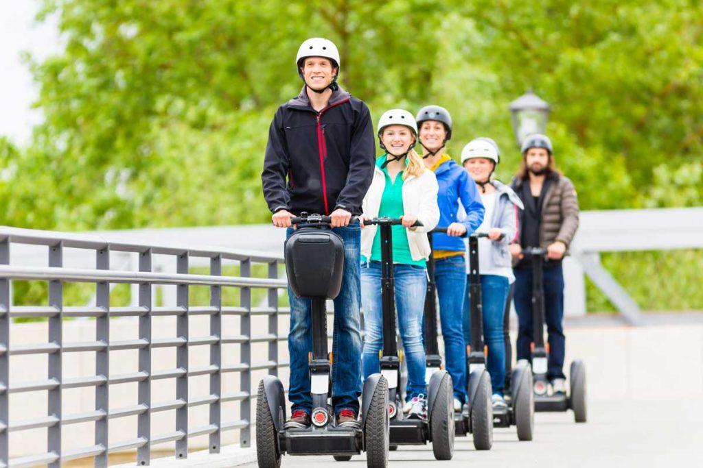 People On Segways | Axiom Communications