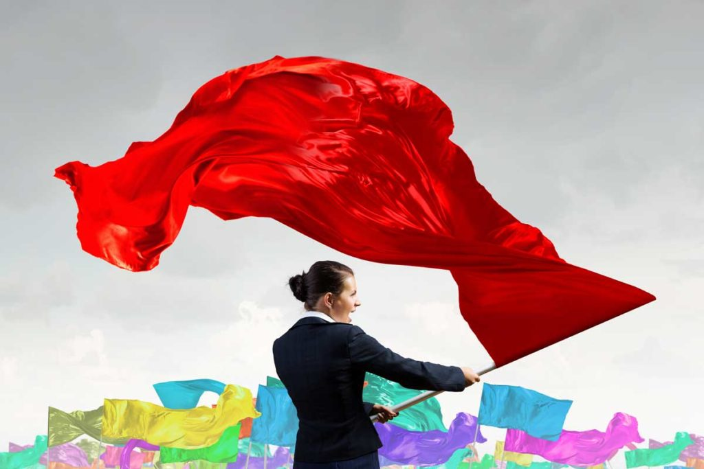 Lady Waving Red Flag | Axiom Communications